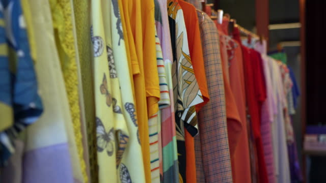 colorful clothing on clothes rack - clothes rail stock videos & royalty-free footage