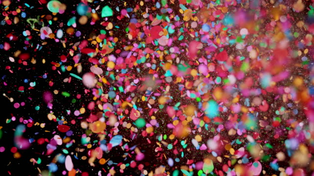 slo mo ld colorful confetti - multi coloured stock videos & royalty-free footage
