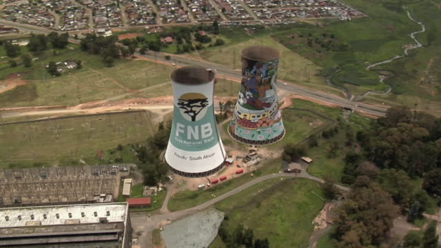 slo mo aerial colorful cooling towers and power plant, soweto, botswana - soweto stock videos and b-roll footage