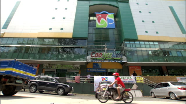 colorful cooyeesan hotel plaza building w/ traffic passing through fg - luzon stock videos & royalty-free footage