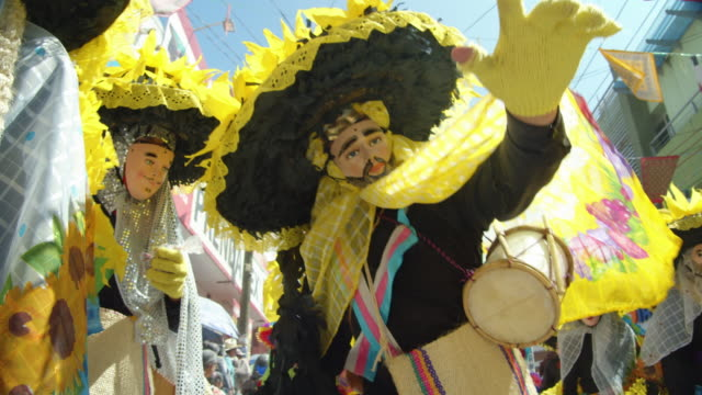 colorful costume parade at zoque coiteco carnival in chiapas village. mexican syncretism tradition - chiapas stock-videos und b-roll-filmmaterial