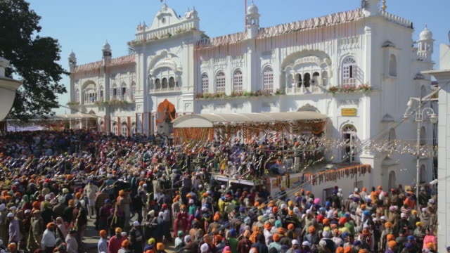 colorful crowd on a sunny day for hola mohalla - punjab india stock videos and b-roll footage
