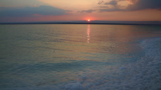 colorful dead sea during sunset. - dead sea stock videos and b-roll footage