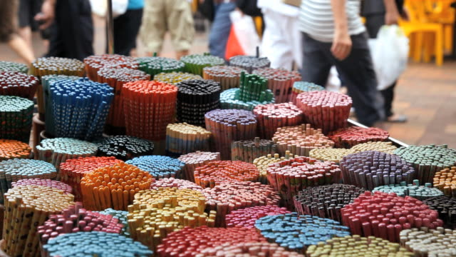 colorful decorative chopsticks for sale as souvenirs to tourists in chinatown market, temple street, singapore, south east asia - temple street market stock videos and b-roll footage