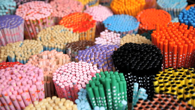 colorful decorative chopsticks for sale as souvenirs to tourists in chinatown market, temple street, singapore, south east asia - product variation stock videos & royalty-free footage