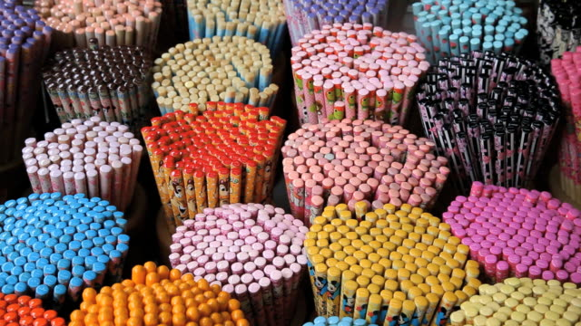 colorful decorative chopsticks for sale as souvenirs to tourists in chinatown market, temple street, singapore, south east asia - short phrase stock videos & royalty-free footage