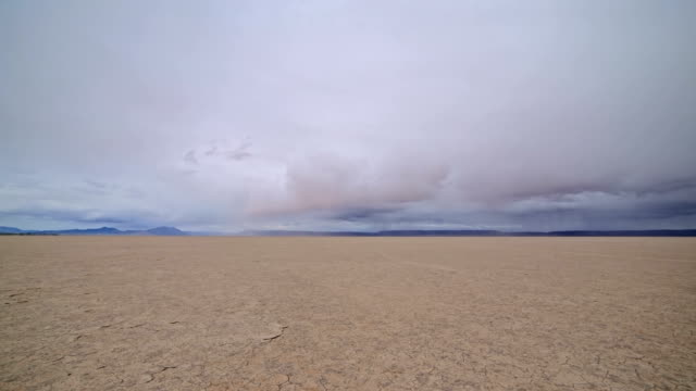 Colorful desert playa cracked earth Alvord Desert and storm 2
