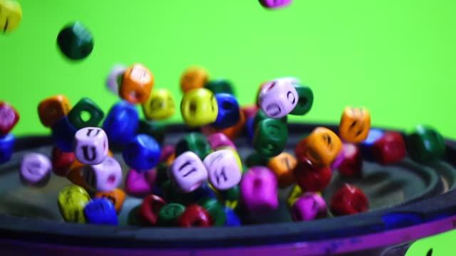 vídeos de stock e filmes b-roll de colorful dice exploding on speaker slow motion - edifício de infantário