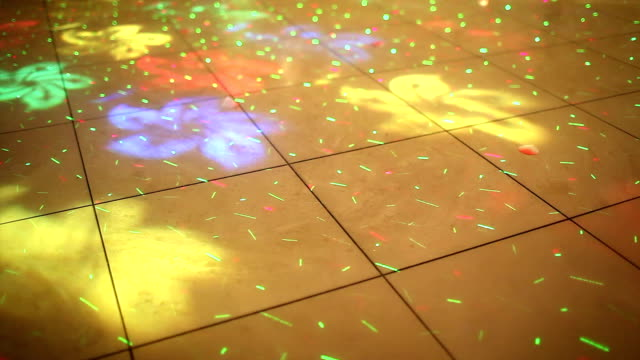 colorful disco lights on a dance floor - dance floor stock videos and b-roll footage