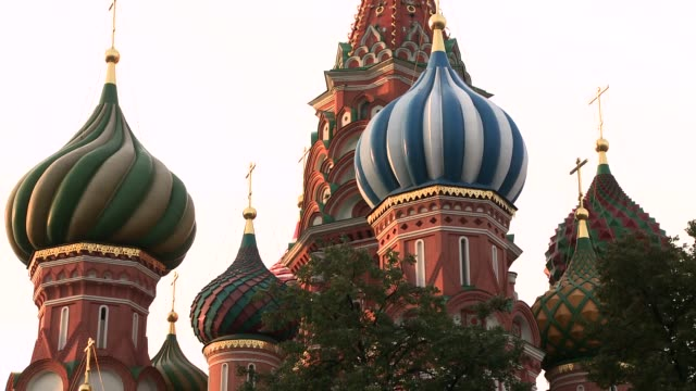 colorful domes top the saint basil's cathedral in red square in moscow, russia. available in hd. - st. basil's cathedral stock videos and b-roll footage