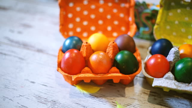 Colorful easter eggs in packing box