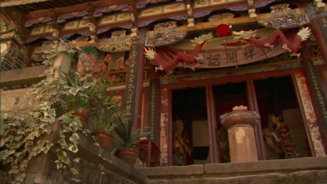 ms la pan colorful facade of taoist temple with carved dragons, weishan, yunnan, china - ancient stock videos & royalty-free footage