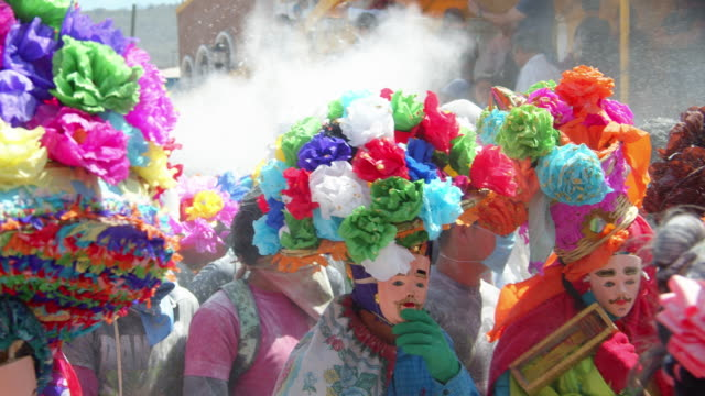 colorful festival costumes and talcum powder sprays at the the zoque coiteco carnival in chiapas, mexico - mexican culture stock videos & royalty-free footage