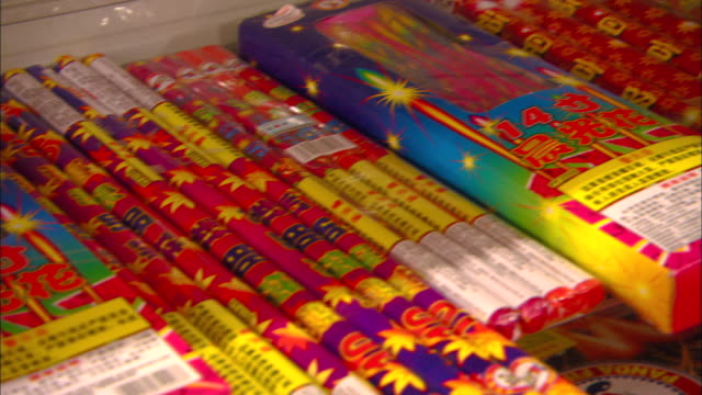 colorful fireworks await sale in a shop in beijing. - sale stock videos & royalty-free footage