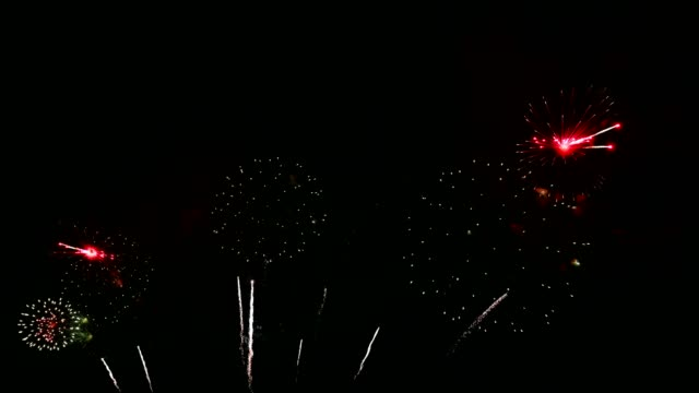 colorful fireworks exploding with shining in annual festival - fiesta background stock videos & royalty-free footage