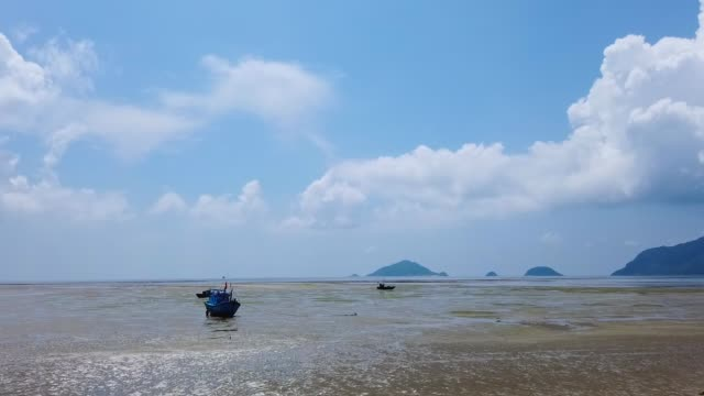 colorful fishing boat tied up on bay ,con island,vietnam - anchored stock videos & royalty-free footage