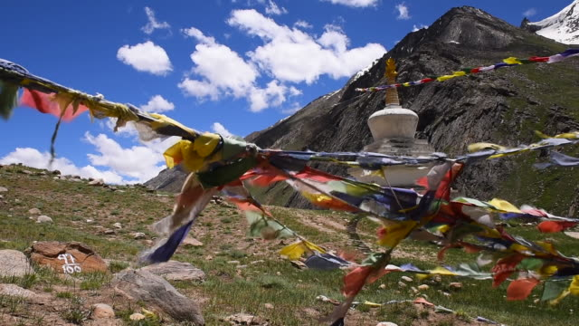 colorful flags and buddhist stupa at himalayas range,jammu kashmir,india - pagoda stock videos & royalty-free footage