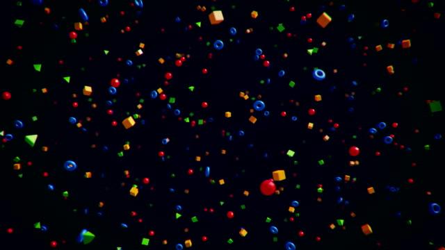 bunte geometrische partikel im orbit - gruppe von gegenständen stock-videos und b-roll-filmmaterial