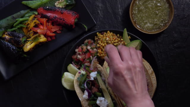 colorful gourmet pulled pork tacos. - gourmet stock videos & royalty-free footage