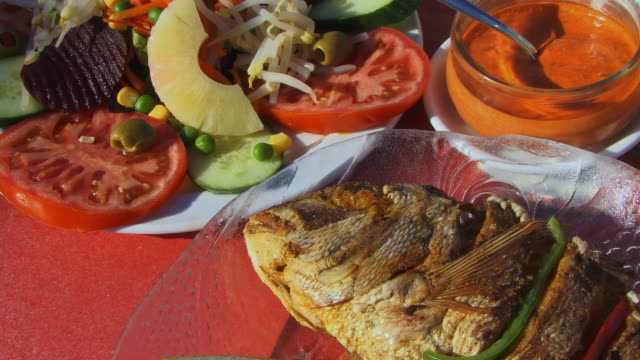 CU PAN Colorful grilled fish and vegetable meal on table/ Fuerteventura, Canary Islands