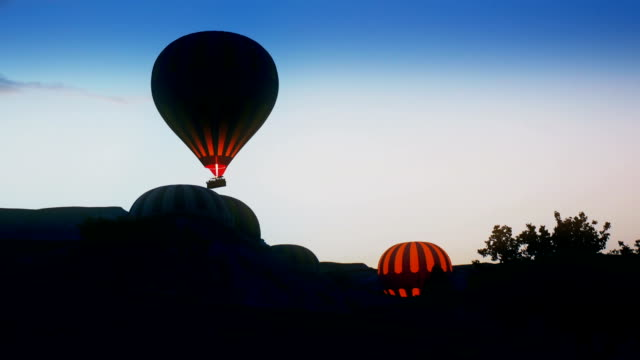 Colorful hot air balloons flying over Red valley