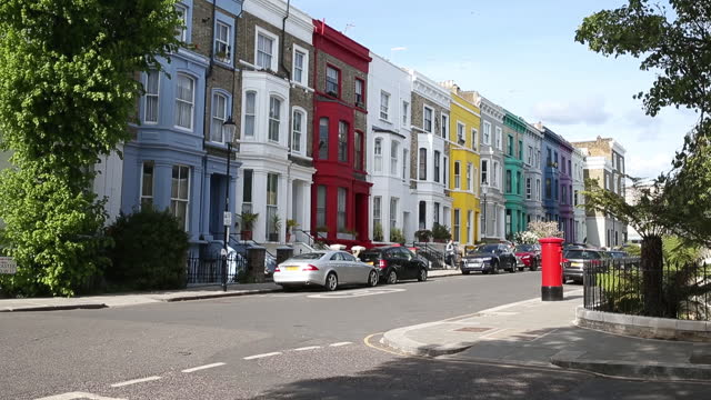 colorful houses on portobello road in notting hill district of london, u.k., on wednesday, may 12, 2021. - incidental people stock videos & royalty-free footage
