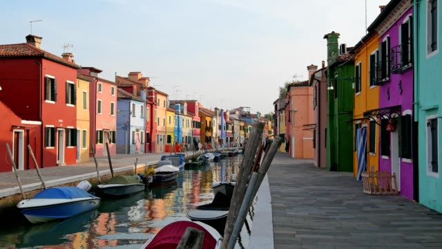 colorful houses with canal and boats in burano, burano, venice, venetian lagoon, veneto, italy - venice italy stock videos and b-roll footage