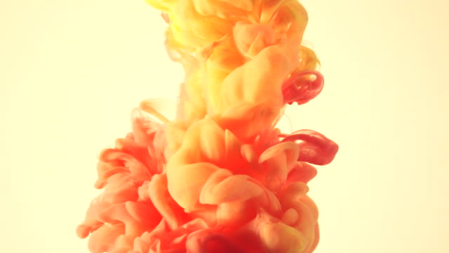 colorful ink floating around in the water - orange stock videos & royalty-free footage