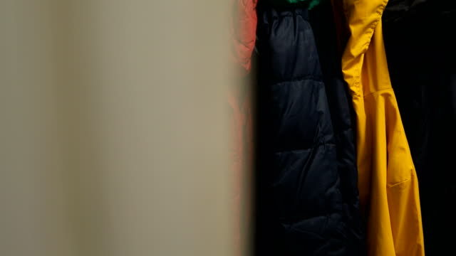 colorful jackets on coat rack - warm clothing stock videos & royalty-free footage