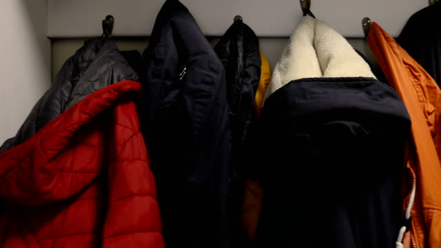 colorful jackets on coat rack - jacket stock videos & royalty-free footage