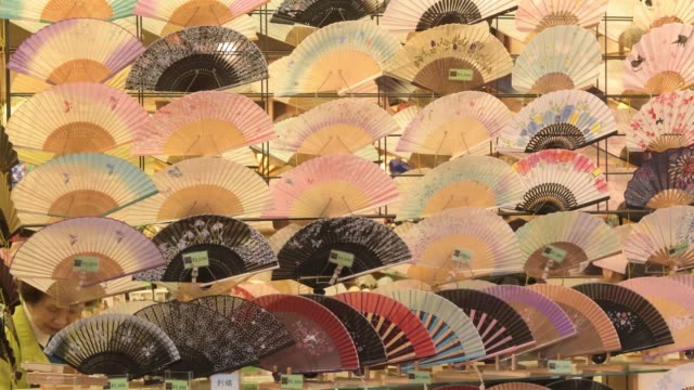 colorful japanese fans on display for tourists in kyoto, japan - hand fan stock videos & royalty-free footage