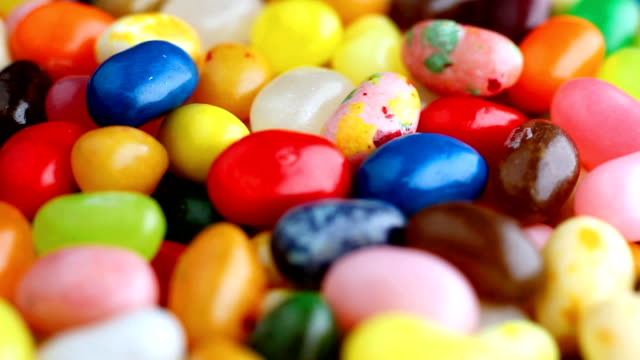 colorful jelly beans pile on top of one another. - jellybean stock videos & royalty-free footage