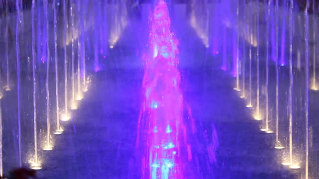 colorful light of fountain at night - fountain stock videos and b-roll footage