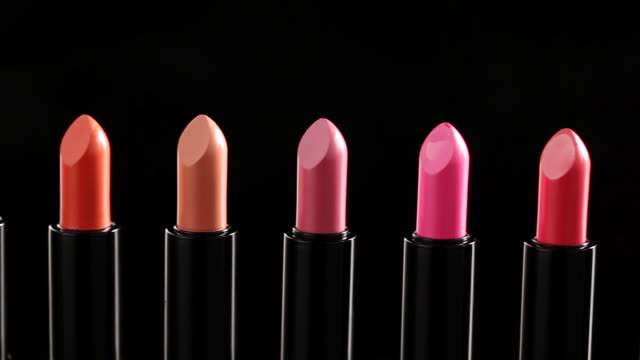cu pan colorful lipsticks placing in row / seoul, south korea - メイクアップ点の映像素材/bロール