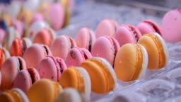 Colorful macarons in showcase of candy shop