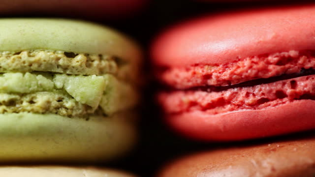 ecu pan colorful macaroon placed in row / seoul, south korea - macaroon stock videos and b-roll footage