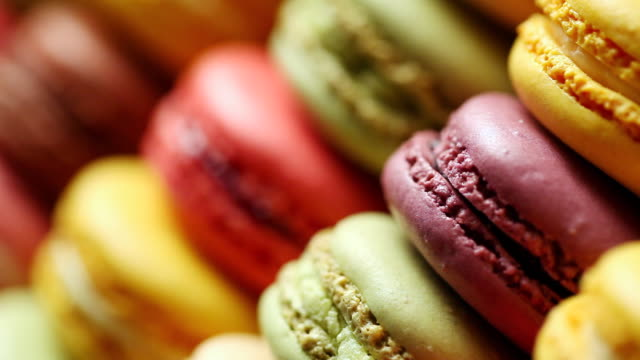 ecu r/f colorful macaroon placed in row / seoul, south korea - macaroon stock videos and b-roll footage