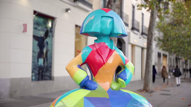 colorful menina figure designed by antonio azzato and sponsored by makro, stands at the intersection of serrano and jorge juan streets, in the... - spotted stock videos & royalty-free footage