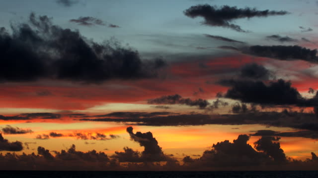 colorful multi colored sky with clouds at sunset - wide stock videos & royalty-free footage