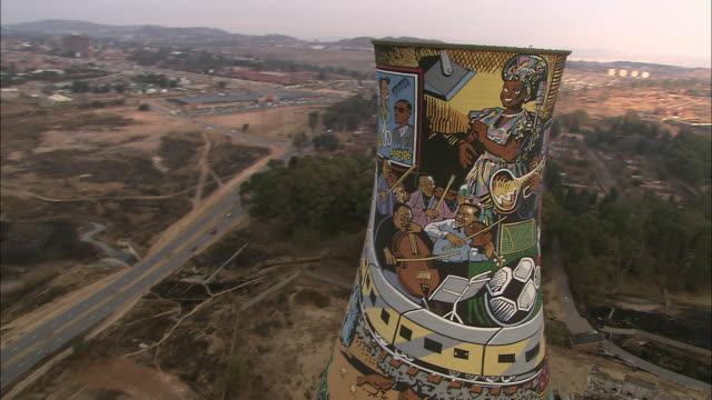 a colorful mural decorates a silo in soweto, johannesburg. - soweto stock videos and b-roll footage