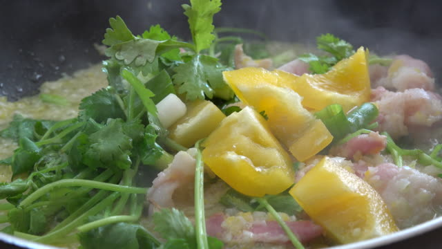 colorful natural food ingredients: close up of condiments and bacon being sauteed in frying pan. there is yellow bell pepper, garlic, onions and cilantro. - condiments stock videos and b-roll footage