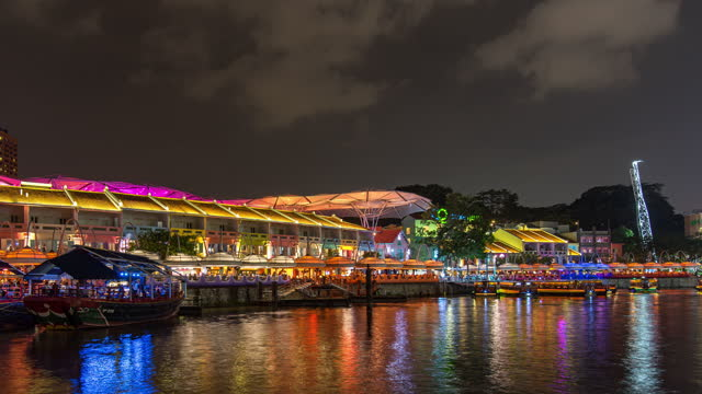 colorful night river with busy tour boats at clarke quay jetty, singapore, time lapse video - singapore river stock videos & royalty-free footage