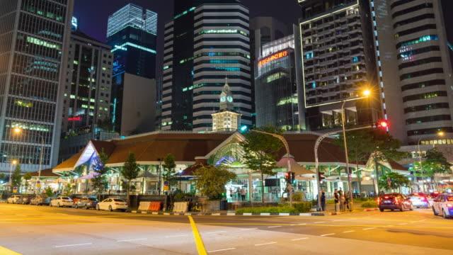 vídeos y material grabado en eventos de stock de colorida noche tráfico entre los rascacielos de singapur, video de lapso de tiempo - vehículo comercial terrestre