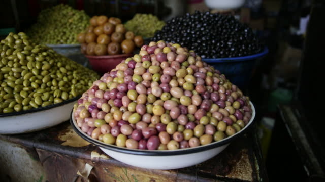 Colorful olives overflowing from bowls