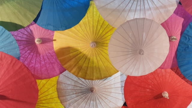colorful paper hand craft umbrellas, handmade in chiang mai, thailand. - painting art product stock videos & royalty-free footage