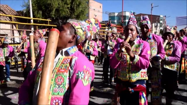 A colorful parade music and an animal sacrifice tradition were part of the opening of Oruros carnival celebrations in Bolivia