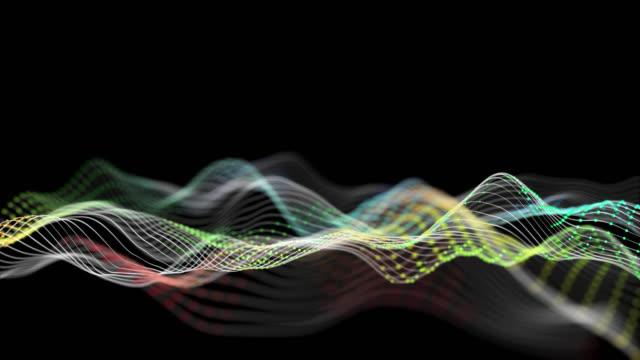 bunte partikelwelle bewegt sich auf dunklen hintergrund, technologie-konzept hintergrund - lichtspur stock-videos und b-roll-filmmaterial