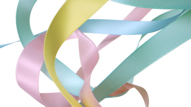 colorful pastel colored ribbons on white background, for celebration events and party for new year, birthday party, christmas or any holidays, waiving and curling in super slow motion and close up - ornate stock videos & royalty-free footage
