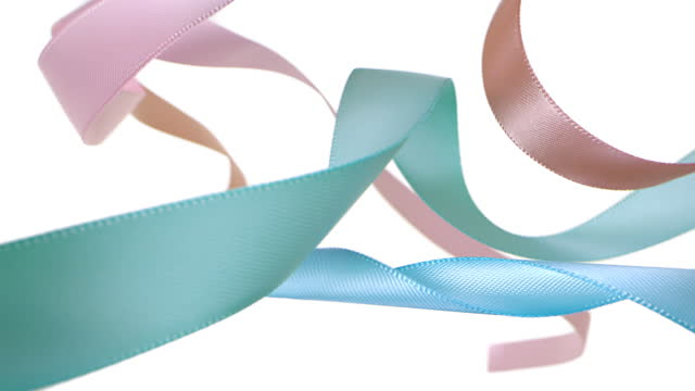 colorful pastel colored ribbons on white background, for celebration events and party for new year, birthday party, christmas or any holidays, waiving and curling in super slow motion and close up - anniversary stock videos & royalty-free footage