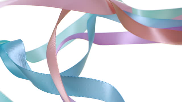 colorful pastel colored ribbons on white background, for celebration events and party for new year, birthday party, christmas or any holidays, waiving and curling in super slow motion and close up - loopable moving image stock videos & royalty-free footage